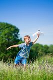 Little boy on meadow Stock Images