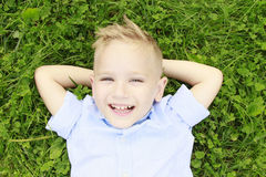 Little boy in the meadow smiling Royalty Free Stock Image