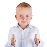 Little boy measures distance between his hands Stock Photography