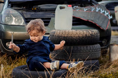 Little boy mechanic repairing the car Royalty Free Stock Image