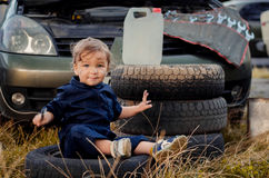 Little boy mechanic repairing the car Stock Images