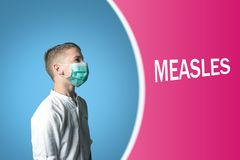 Little boy in a medical mask on a bright background with inscription MEASLES.  stock photos