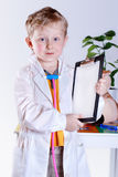 Little boy with medical tools Stock Photos