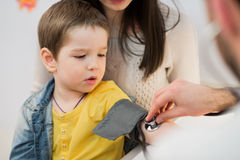 Little boy medical visit - doctor measuring blood pressure of a child Royalty Free Stock Photo