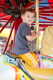 Little boy on a Merry go Round Stock Photos