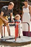 Little boy on merry-go-round Stock Photos