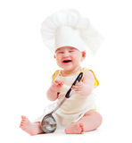 Little boy with metal ladle and chef hat isolated Stock Image