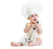 Little boy with metal ladle and cook hat isolated Royalty Free Stock Photos