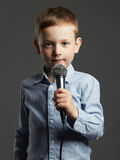 Little boy with microphone.child singing in karaoke Stock Photos
