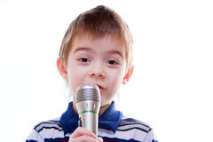 Little boy with a microphone in his hands Royalty Free Stock Images