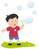 Little Boy mit Seifen-Luftblasen Lizenzfreies Stockbild