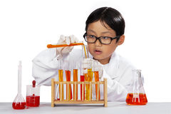 Little boy mixes the chemistry Stock Photos
