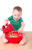 Little boy mixes dough Stock Photography