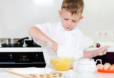 Little boy mixing cake ingredients Royalty Free Stock Image