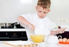 Little boy mixing cake ingredients Royalty Free Stock Image