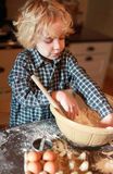 Little boy mixing flour in a bowl Royalty Free Stock Photography