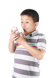 Little boy with  mobile phone in hand isolated on white backgrou Royalty Free Stock Photography