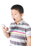 Little boy with  mobile phone in hand isolated on white background Royalty Free Stock Images