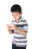 Little boy with  mobile phone in hand isolated on white background Royalty Free Stock Photos