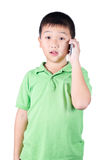 Little boy with  mobile phone isolated on white background Royalty Free Stock Photography