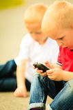 Little boy with mobile phone outdoor. Technology generation. Royalty Free Stock Photos