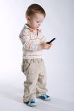 Little boy with mobile phone Stock Image