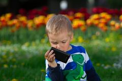 Little boy and mobile phone. Royalty Free Stock Photo