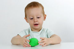 Little boy and modeling clay Royalty Free Stock Photography