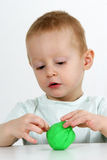 Little boy and modeling clay Stock Image