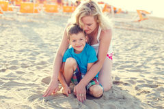 Little boy with mom on beach Royalty Free Stock Photos