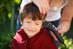 Little boy with mom haircut Stock Photo