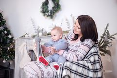 Little boy and mom holding bunny. New Year`s holiday, preparation for Christmas. Family idyll Royalty Free Stock Photos