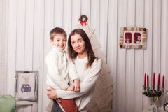Little boy with mom posing in Christmas interior Royalty Free Stock Image