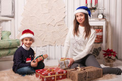 Little boy with mom posing in Christmas interior Stock Image
