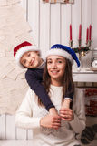 Little boy with mom posing in Christmas interior Stock Images