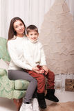 Little boy with mom posing in Christmas interior Royalty Free Stock Photos