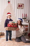Little boy with mom posing in Christmas interior Stock Photo