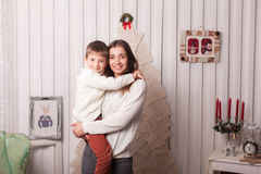 Little boy with mom posing in Christmas interior Royalty Free Stock Images