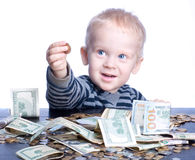 Little boy with money Royalty Free Stock Photos