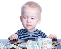 Little boy with money Stock Images