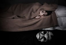 Little boy and monster under the bed. royalty free stock image