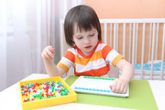 Little boy with mosaic Royalty Free Stock Image