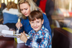Little boy with mother in fast food restaurant Royalty Free Stock Photos