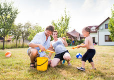 Little boy with mother and father splashing each other Stock Image
