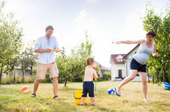 Little boy with mother and father splashing each other Stock Photography