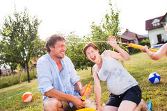 Little boy with mother and father splashing each other Royalty Free Stock Photo