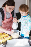Little boy and  mother having fun with baking Stock Photo