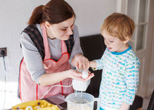 Little boy and  mother having fun with baking Royalty Free Stock Photography