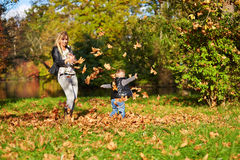 Little boy and mother playing together Stock Images