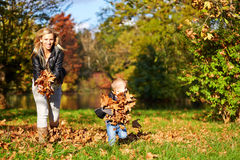 Little boy and mother playing together Stock Image